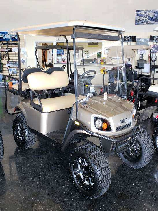 2018 EZGO TXT Gold Lifted Electric Certified Pre-Owned (2014)